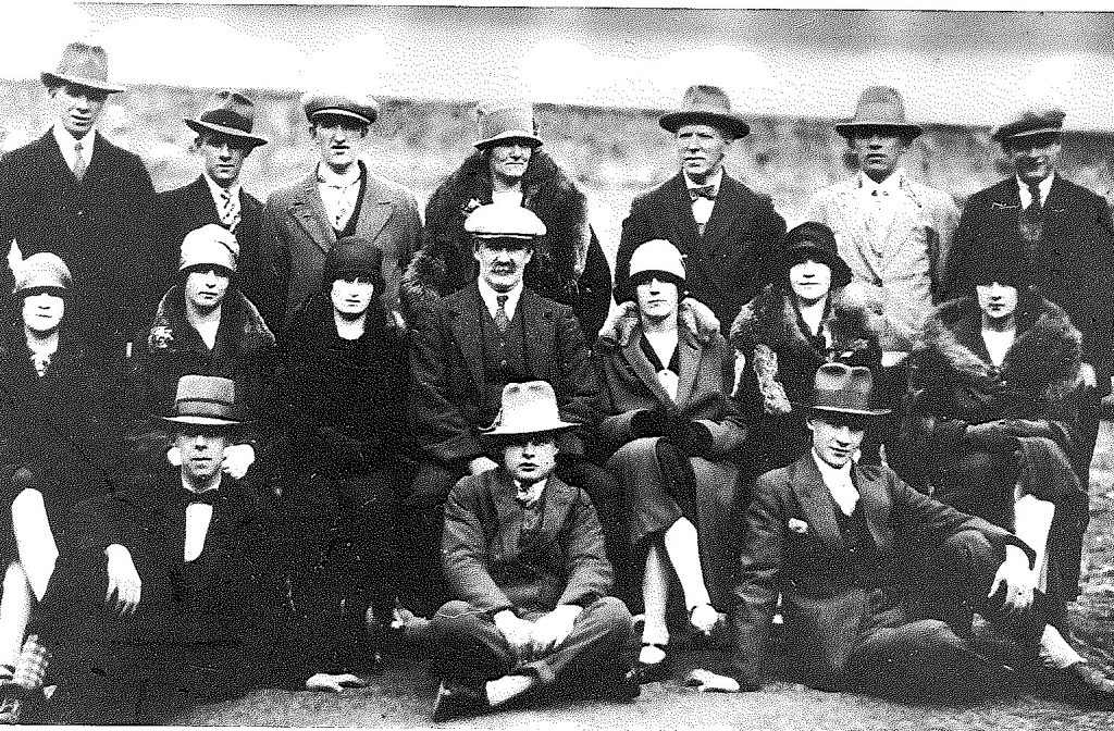 Black and white photograph of seventeen men and women comprising the original Bowhill Players. Photo taken on tour in 1929