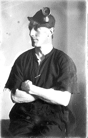 Black and white photograph of Joe Corrie in his miner's working clothes,1923